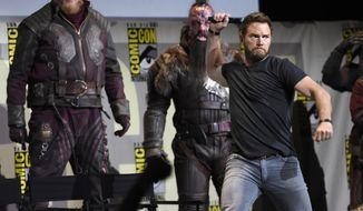 """Chris Pratt gestures to the audience at the """"Guardians of the Galaxy Vol. 2"""" panel on day 3 of Comic-Con International on Saturday, July 23, 2016, in San Diego. (Photo by Chris Pizzello/Invision/AP)"""