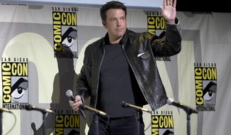 """Ben Affleck walks on stage at the """"Justice League"""" panel on day 3 of Comic-Con International on Saturday, July 23, 2016, in San Diego. (Photo by Chris Pizzello/Invision/AP)"""