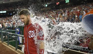 Washington Nationals' Stephen Drew gets doused with water after the team's baseball game against the San Diego Padres, Saturday, July 23, 2016, in Washington. Drew hit a walk-off triple that scored Anthony Rendon. The Nationals won 3-2. (AP Photo/Nick Wass)