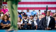 Members of the secret service stand nearby as Democratic presidential candidate Hillary Clinton speaks at a rally in Entertainment Hall at the Florida State Fairgrounds in Tampa on July 22, 2016. (Associated Press) **FILE**