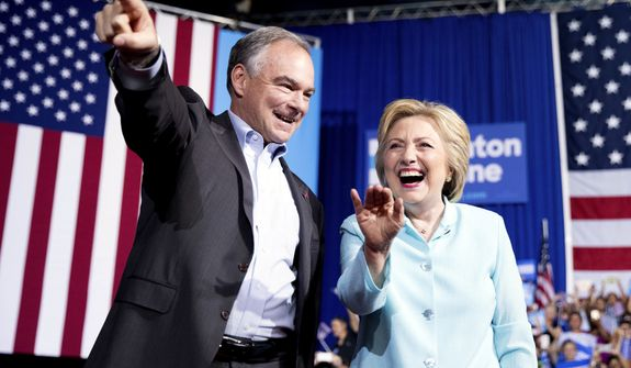 Democratic presidential candidate Hillary Clinton and Sen. Tim Kaine, D-Va., arrive at a rally at Florida International University Panther Arena in Miami, Saturday, July 23, 2016. Clinton has chosen Kaine to be her running mate. (AP Photo/Andrew Harnik)