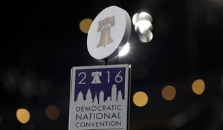 A sign atop a post to mark a delegation area is seen in the convention hall before the start of the 2016 Democratic Convention in Philadelphia, Saturday, July 23, 2016. (AP Photo/Carolyn Kaster)