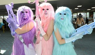 """Fans dressed as """"Chewie's Angels"""" pose for a photo on day two of Comic-Con International held at the San Diego Convention Center Friday, July 22, 2016, in San Diego.  (Photo by Denis Poroy/Invision/AP)"""