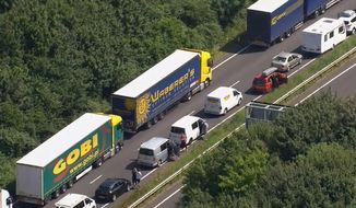In this aerial view taken from video, part of the miles long queue of traffic outside Dover, England, waiting to cross the English Channel into France, Saturday July 23, 2016, as France is under a state of emergency.  Heightened French border security checks caused massive disruption for many hours Saturday as some thousands of travelers tried to make the journey into France.  (Sky via AP)