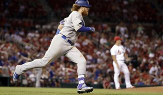 Los Angeles Dodgers' Justin Turner, left, rounds the bases after hitting a solo home run off St. Louis Cardinals relief pitcher Seung Hwan Oh, right, during the ninth inning of a baseball game Friday, July 22, 2016, in St. Louis. (AP Photo/Jeff Roberson)
