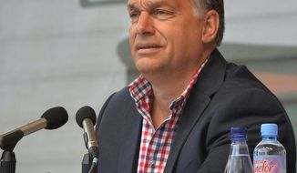 Hungarian Prime Minister Viktor Orban delivers his speech during the 27th Balvanyos Summer University and Students' Camp in Baile Tusnad, central Romania, Saturday, July 23, 2016. The week-long Balvanyos Summer University and Camp is held annually since 1990 and it's one of the most important national political workshops of Hungary's governing Fidesz - Hungarian Civic Alliance. This is the biggest public forum of Hungary's dialogue with the ethnic Hungarian minority and with Romania. Beyond the lectures and roundtables there are rich variety of cultural programmes, including plenty of concerts in each year. (Zoltan Mathe/MTI via AP)
