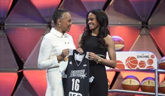 In this April 14, 2016 file photo, Connecticut's Moriah Jefferson, right, and WNBA President Lisa Borders hold a San Antonio Stars jersey after Jefferson was selected with the second pick in the WNBA basketball draft  in Uncasville, Conn. WNBA President Borders applauds the league's players for taking a stance on social issues. She just wishes the activism was kept off the court. Borders spent the past two weeks talking with the union and its executive council, trying to come up with ways that both the league and its players could constructively address the Black Lives Matters movement. Nothing concrete was decided.  (Cloe Poisson/Hartford Courant via AP, File)