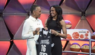 In this April 14, 2016 file photo, Connecticut's Moriah Jefferson, right, and WNBA President Lisa Borders hold a San Antonio Stars jersey after Jefferson was selected with the second pick in the WNBA basketball draft  in Uncasville, Conn.  (Cloe Poisson/Hartford Courant via AP, File) **FILE**