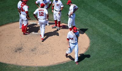 Washington Nationals pitcher Lucas Giolito (44) walks toward the dugout after he was pulled in the fourth inning from Sunday's 10-6 loss to the San Diego Padres. Giolito was unsteady and inaccurate for the second time in his three major-league starts. (Associated Press)