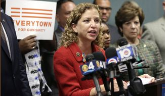FILE - In a Tuesday, July 5, 2016 file photo, Congresswoman Debbie Wasserman Schultz, D-Fla., speaks during a news conference, in Fort Lauderdale, Fla. On Sunday, July 24, 2016, Wasserman Schultz announced she would step down as DNC chairwoman at the end of the party's convention. Her resignation follows the leak of some 19,000 emails, presumably stolen by hackers and posted to the website Wikileaks, that suggest the DNC favored Hillary Clinton over Bernie Sanders.  (AP Photo/Lynne Sladky, File)