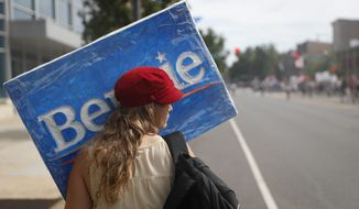 Supporters of Sen. Bernie Sanders, I-Vt., march during a protest in downtown on Sunday, July 24, 2016, in Philadelphia. The Democratic National Convention starts Monday in Philadelphia. (AP Photo/John Minchillo)
