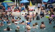 People try to stay cool at Fair Lawn, N.J. Memorial Pool, Sunday, July 24, 2016 as hot temperatures continue to across the region. Experts say the heat wave gripping most of the United States bringing triple-digit temperatures to many regions is not expected to go away anytime soon. (Carmine Galasso/The Record of Bergen County via AP)