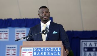 National Baseball Hall of Fame inductee Ken Griffey Jr. speaks during an induction ceremony at the Clark Sports Center on Sunday, July 24, 2016, in Cooperstown, N.Y. (AP Photo/Mike Groll)