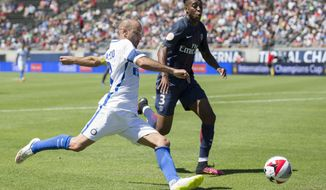 Inter Milan forward Rodrigo Palacio (8), left, winds up to cross the ball under defensive pressure by Paris Saint-Germain defender Presnel Kimpembe (3), right, during an  International Champions Cup match in Eugene, Ore., Sunday, July 24, 2016. (Adam Eberhardt/The Register-Guard via AP)