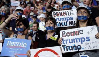 Michigan delegates didn't have to utter a word Monday to express their feelings about the Democratic presidential contest. Despite calls for party unity, Hillary Clinton backers engaged in a war of words with supporters of rival Bernard Sanders. (Associated Press photographs)