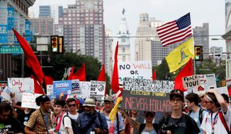 Demonstrators make their way around Philadelphia to protest Hillary Clinton during the first day of the Democratic National Convention. (Associated Press)