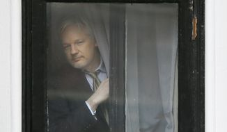 """""""This is a diversion that's being pushed by the Hillary Clinton campaign. That's a meta-story. The real story is what these emails contain and they show collusion"""" by top party leaders to rig the presidential-primary process in favor of Mrs. Clinton, WikiLeaks founder Julian Assange said. (Associated Press)"""