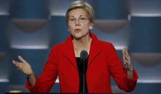 Sen. Elizabeth Warren took repeated shots at Republican Donald Trump, with whom she's had an ongoing, often nasty Twitter war. But the focal point of her address was getting disenchanted progressives to finally give up their fight against Hillary Clinton once and for all, or risk the possibility of a Trump presidency. (Associated Press)