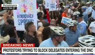 Democracy Spring activists protest at the Democratic National Convention in Philadelphia on July 25, 2016. (CNN screenshot)