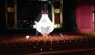 """The chandelier, which plays an important part in the """"The Phantom of the Opera,"""" is rigged as part of the touring production at the Kennedy Center in Washington, D.C.  (Cheryl Danehart)"""