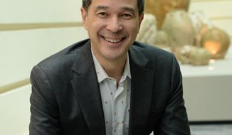 In this  June 2016 photo provided by the Asian Civilisations Museum, courtesy of the Currier Museum of Art, Alan Chong poses for a picture. The Currier Museum of Art announced Chong has been named the new art director and CEO. (Asian Civilisations Museum/ Courtesy of Currier Museum of Art via AP)