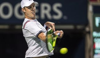 Sam Querrey, of the United States, returns the ball against Frank Dancevic, of Canada, during men's first round Rogers Cup tennis action in Toronto on Monday, July 25, 2016. (Aaron Vincent Elkaim/The Canadian Press via AP)