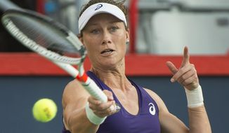 Samantha Stosur, of Australia, returns to Heather Watson, of Britain, during their first round match at the Rogers Cup tennis tournament in Montreal, Monday, July 25, 2016. (Graham Hughes/The Canadian Press via AP)