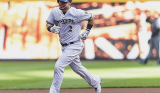 Milwaukee Brewers' Scooter Gennett rounds the bases after hitting a solo home run of of Arizona Diamondbacks' Braden Shipley batter during the first inning of a baseball game Monday, July 25, 2016, in Milwaukee. (AP Photo/Tom Lynn)