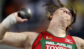 FILE In this Sunday, Aug. 26, 2007 file photo Nadzeya Ostapchuk from Belarus makes an attempt in the final of the Women's Shot Put during the World Athletics Championships, in Osaka, Japan. While the scandal of Russian doping threatens to be one of the main talking points of the Rio Olympics, other countries are slipping under the radar despite sharing the tainted legacy of the Soviet sports system. (AP Photo/David J. Phillip, File)