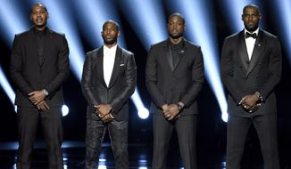 FILE - In this July 13, 2016, file photo, NBA basketball players Carmelo Anthony, Chris Paul, Dwyane Wade and LeBron James, from left, speak on stage at the ESPY Awards in Los Angeles. The four gave an anti-violence speech and expressed their support of the values behind the Black Lives Matter movement.(Photo by Chris Pizzello/Invision/AP, File)