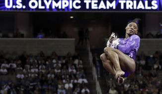 FILE - In this July 8, 2016, file photo, Simone Biles competes on the uneven bars during the women's U.S. Olympic gymnastics trials in San Jose, Calif. Biles is one of 25 athletes fans should follow on social media ahead of the Olympics. (AP Photo/Gregory Bull, File)