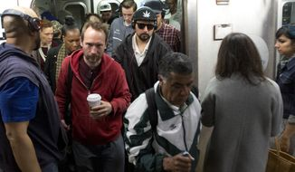 In this May 24, 2016, photo, subway commuters exit a crowded L train in New York. The L train's tunnel between Manhattan and Brooklyn will close for 18 months, starting in 2019 to repair damage caused by Superstorm Sandy. (AP Photo/Mark Lennihan)