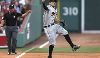 Detroit Tigers third baseman Nick Castellanos (9) makes the throw on a ground out by Boston Red Sox's Dustin Pedroia during the first inning of a baseball game at Fenway Park, Monday, July 25, 2016, in Boston. At rear is umpire Manny Gonzalez. (AP Photo/Charles Krupa)