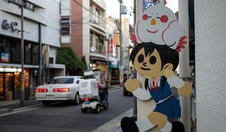 "This Oct. 18, 2014 photo shows fan art from the anime series ""Tamako Market"" at the Demachi Masugata Shotengai in Kyoto, Japan. Anime tourism is a phenomenon in Japan, with fans hunting down real-world places that are used as settings in the cartoons. (Michael Vito via AP)"
