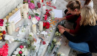 Flowers, candles and messages are placed outside the home of the Rev. Jacques Hamel, a Catholic priest who was forced to his knees by Islamic State terrorists before his killing during morning Mass in northern France. (Associated Press)