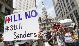 Supporters of Sen. Bernie Sanders, I-Vt., make their way around downtown while a protesting, Monday, July 25, 2016, in Philadelphia, during the first day of the Democratic National Convention. (AP Photo/John Minchillo)