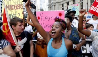 """Hell no, DNC/We won't vote for Hillary,"" demonstrators chanted during a Black Lives Matter protest during the second day of the Democratic National Convention. (Associated Press)"