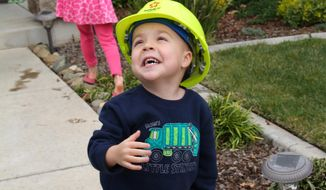 This February 2014 photo taken by Arnell Elegue and provided by the Make A Wish Foundation shows Ethan Dean in Rancho Cordova, Calif. Dean, 6, who has cystic fibrosis, will have his dream to be a garbage man come true with help of the Make-A-Wish Foundation. Dean will ride along on a garbage truck collecting trash at various locations in Sacramento, Calif., Tuesday, July 26, 2016. (Arnell Elegue/Make A Wish Foundation via AP)