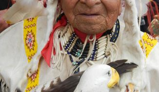 FILE - In this 2013 file photo, Chief David Beautiful Bald Eagle Jr., is seen in Deadwood, S.D. Bald Eagle, a longtime representative of South Dakota's Lakota people, died Friday, July 22, 2016, at home on the Cheyenne River Indian Reservation. He was 97. (Tom Griffith/Rapid City Journal via AP, File)