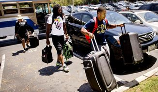 Los Angeles Rams rookie cornerback Rohan Gaines, right, carries his bags to check in for NFL football training camp at the University of California, Irvine after getting off a bus Tuesday, July 26, 2016, in Irvine, Calif. Paul Rodriguez/The Orange County Register via AP)