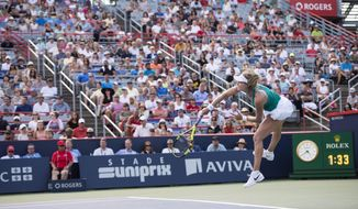 Canada's Eugenie Bouchard serves to Lucie Safarova of the Czech Republic during first round of play at the Rogers Cup tennis tournament Tuesday, July 26, 2016 in Montreal. (Paul Chiasson/The Canadian Press via AP)