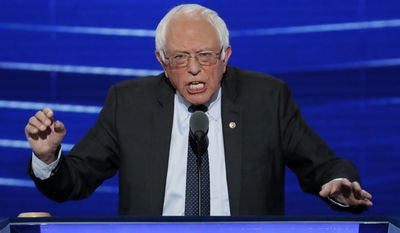 """""""This campaign is about moving the United States toward universal health care and reducing the number of people who are uninsured or underinsured,"""" Sen. Bernard Sanders told the Democratic National Convention in Philadelphia late Monday. """"Hillary Clinton wants to see that all Americans have the right to choose a public option in their health care exchange."""" (Associated Press)"""