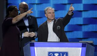 Democratic Vice Presidential candidate, Sen. Tim Kaine, D-Va., looks over the podium as he checks out the stage before the start of the third day session of the Democratic National Convention in Philadelphia, Wednesday, July 27, 2016. (AP Photo/John Locher)