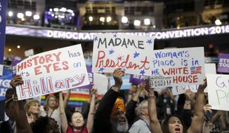 California delegates hold up signs as they cheer during the third day session of the Democratic National Convention in Philadelphia, Wednesday, July 27, 2016. (AP Photo/Matt Rourke)