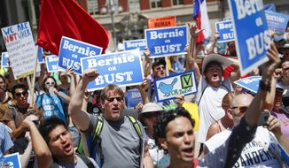 Supporters of Sen. Bernie Sanders, I-Vt., yell during a rally near City Hall in Philadelphia, Tuesday, July 26, 2016, during the second day of the Democratic National Convention. (AP Photo/John Minchillo)