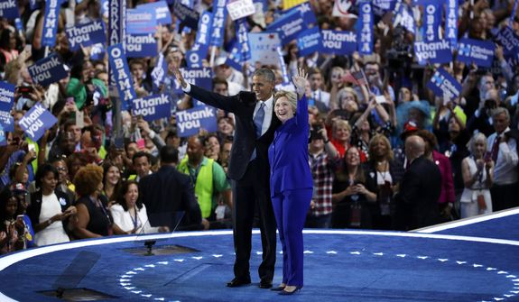 President Obama and Democratic presidential nominee Hillary Clinton wave to the crowd during the third day of the Democratic National Convention on Wednesday in Philadelphia. (Associated Press)