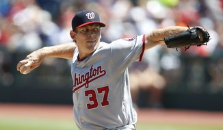 Washington Nationals starting pitcher Stephen Strasburg delivers against the Cleveland Indians during the first inning of a baseball game Wednesday, July 27, 2016, in Cleveland. (AP Photo/Ron Schwane)