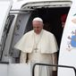 Pope Francis steps out from the plane as he arrives at the military airport in Krakow, Poland, Wednesday, July 27, 2016. The world is at war, but it is not a war of religions, Pope Francis said Wednesday as he traveled to Poland on his first visit to Central and Eastern Europe in the shadow of the slaying of a priest in France. (AP Photo/Alik Keplicz)