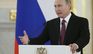 Russian President Vladimir Putin speaks at the Kremlin, in Moscow, Russia, Wednesday, July 27, 2016 during a reception for the Russia's Olympics team. (AP Photo/Alexander Zemlianichenko)