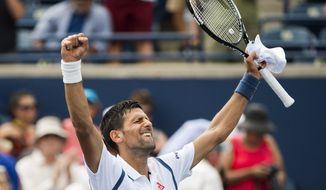 Novak Djokovic, of Serbia, reacts after defeating Gilles Muller, of Luxembourg, during a second round match at the Rogers Cup tennis tournament in Toronto, Wednesday, July 27, 2016. (Nathan Denette/The Canadian Press via AP)